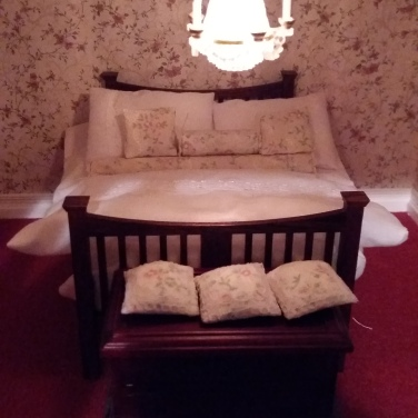 Edwardian bed from McQueenie Miniatures and linen from Dolls House Emporium